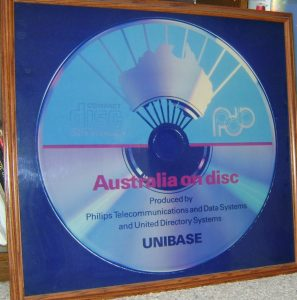 "Framed photograph (2' 6"" square) of the first Australia On Disc - presented to United Directory Systems May 1988"